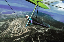Paul Hamilton soaring on his hang glider at 12,000 MSL after launching from the mountains below at 8200 MSL