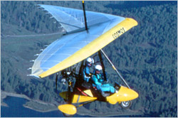 Trike in flight, called weight-shift control (WSC) aircraft by the FAA