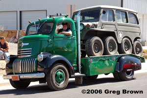 A Fun Run participant shows off his 1930s cab-over-engine Chevrolet truck hauling an eight-wheel Jeep.