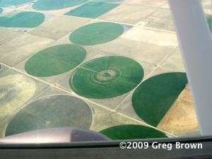 Featureless barrens give way to irrigation circles in western Kansas.
