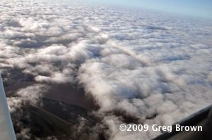 The Mississippi River peeks from beneath clouds on the last leg to Oshkosh.
